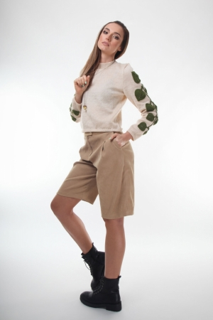 Beige knitted sweater for women long  sleeves  with crocheted and applied green leaves.