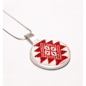 Silver pendant with red traditional motif