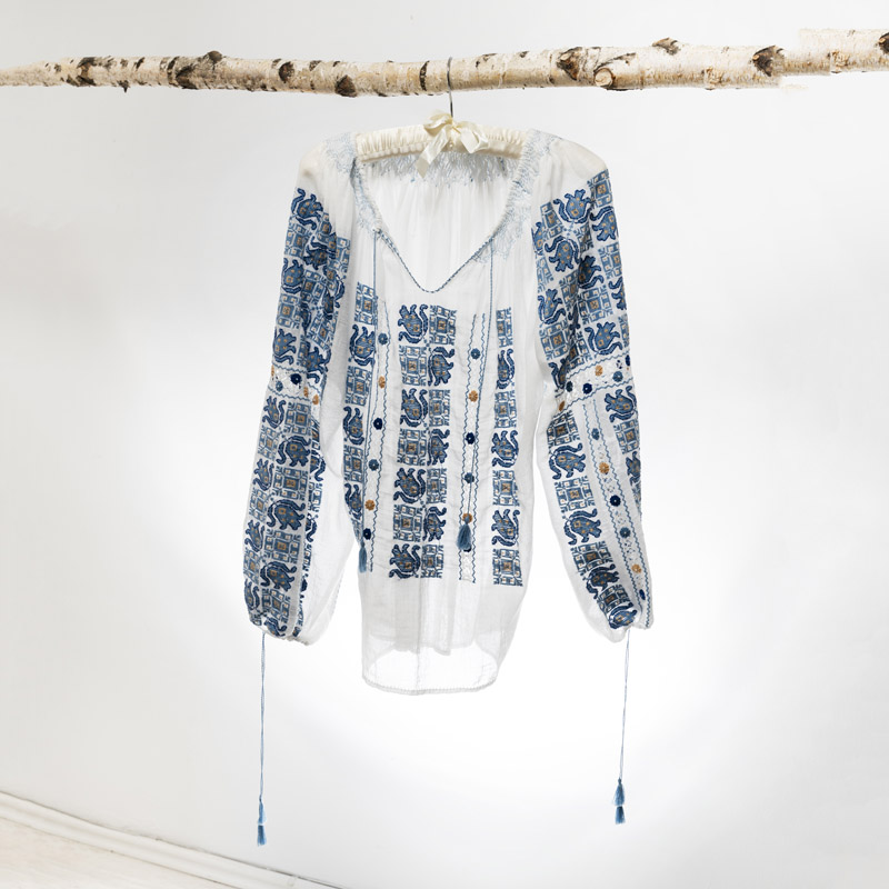 Romanian blouse handmade by artisans in white linen cloth and traditional blue motif embroidery