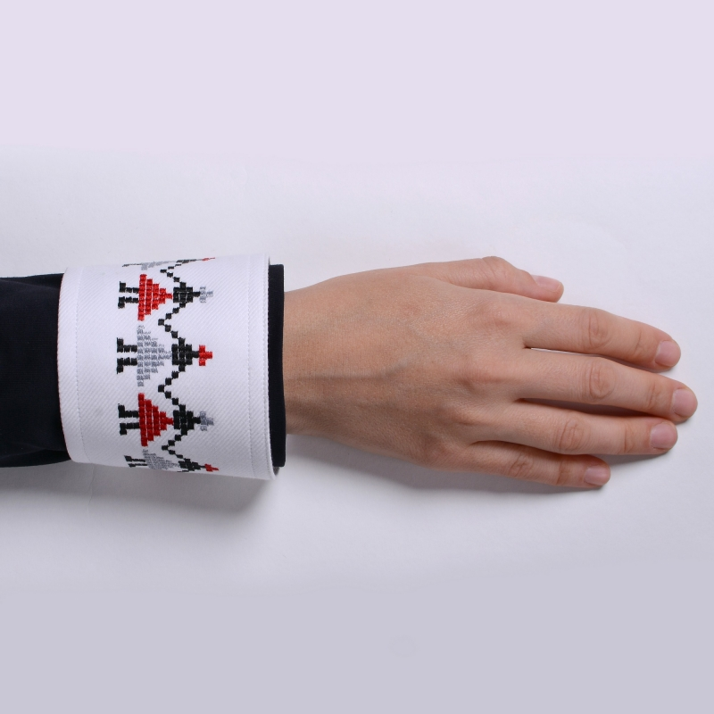 Shirt cuff with embroidered motifs